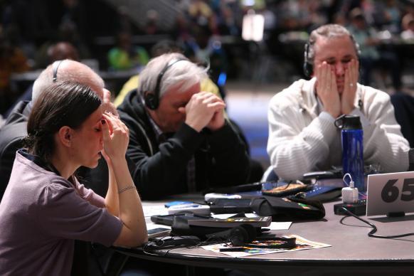 final_wrap_2_delegates_pray-582x388